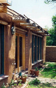 solar adobe with inexpensive shading device in historic Santa Fe, New Mexico